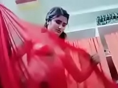 Swathi naidu showing her body and wearing red saree